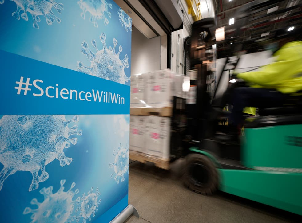 <p>Boxes containing the Pfizer-BioNTech coronavirus vaccine are loaded onto a truck for shipping&nbsp;</p>