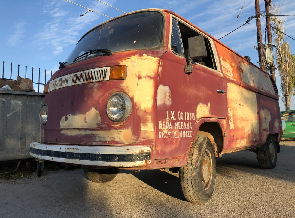 <p>Free expression: an ancient VW van along the road to Poros</p>