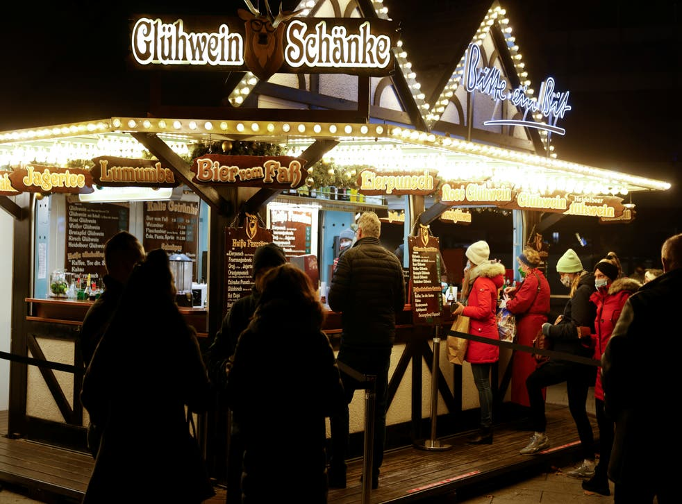 <p>Local restaurant owners are offering hot mulled wine, or Gluhwein, from the steps of their shuttered eateries</p>