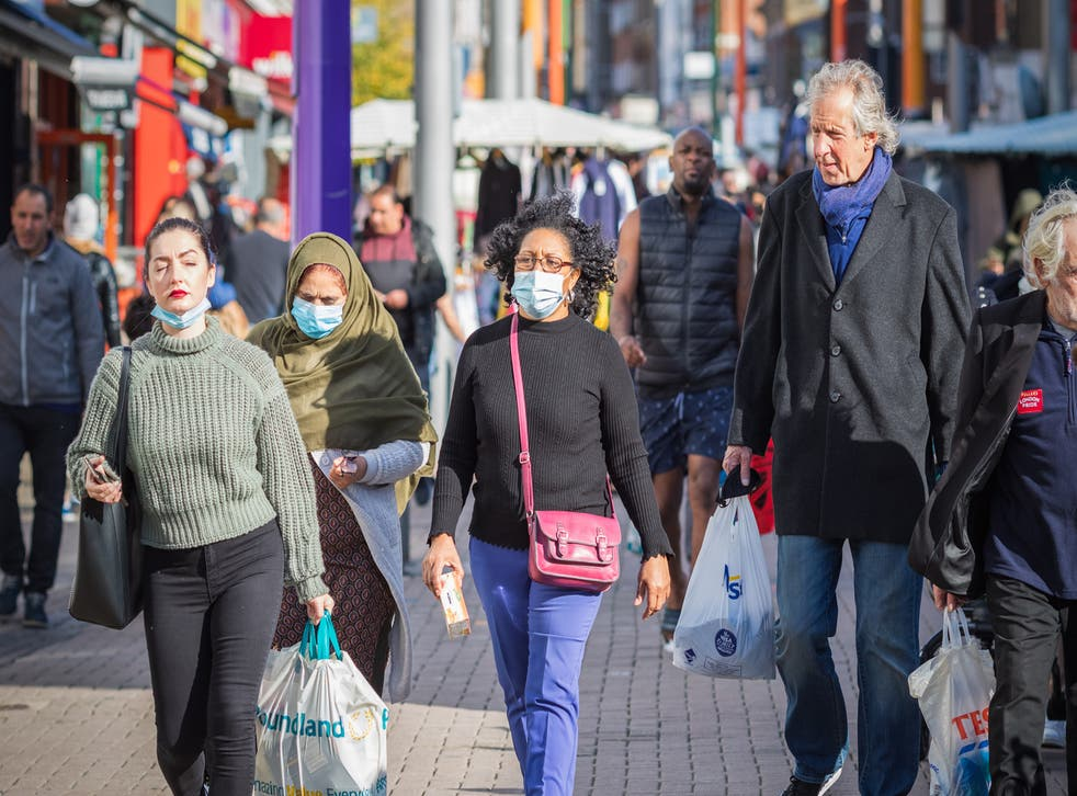 People wearing face masks while shopping at Walthamstow market in London