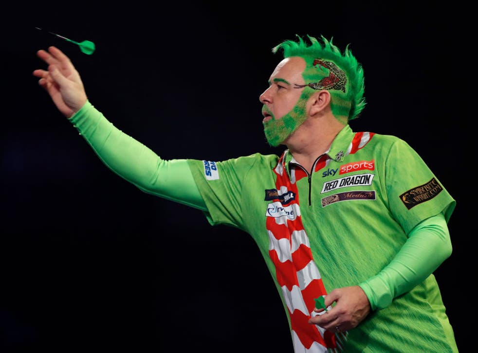 <p>Peter Wright of Scotland in action during his round two match against Steve West</p>