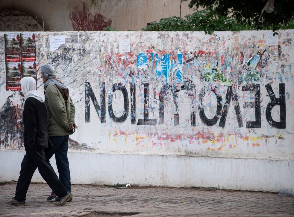 <p>A revolution turned upside down. Graffiti in Sidi Bouzid, central Tunisia</p>