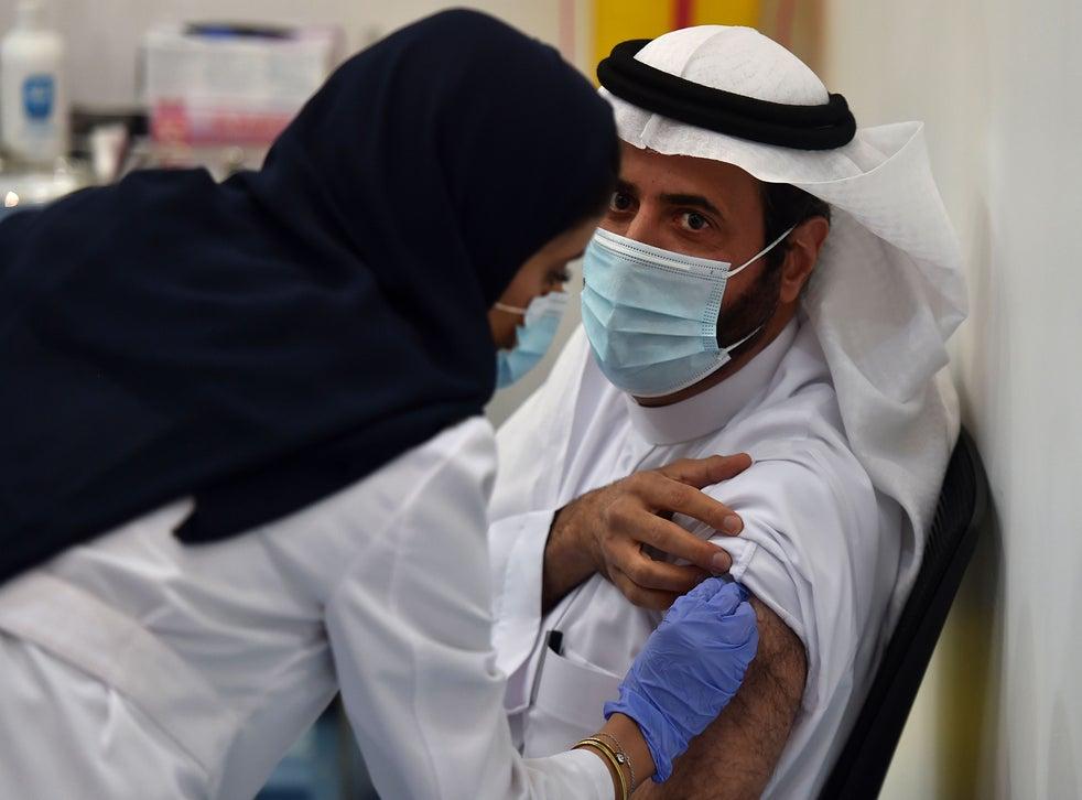 Saudi Arabia's Health Minister Tawfiq al-Rabiah receiving the Pfizer-BioNTech COVID-19 coronavirus vaccine (Photo by FAYEZ NURELDINE/AFP via Getty Images)