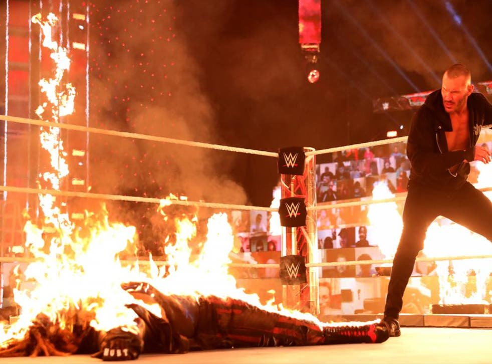 Randy Orton watches on after setting Bray Wyatt on fire at WWE TLC