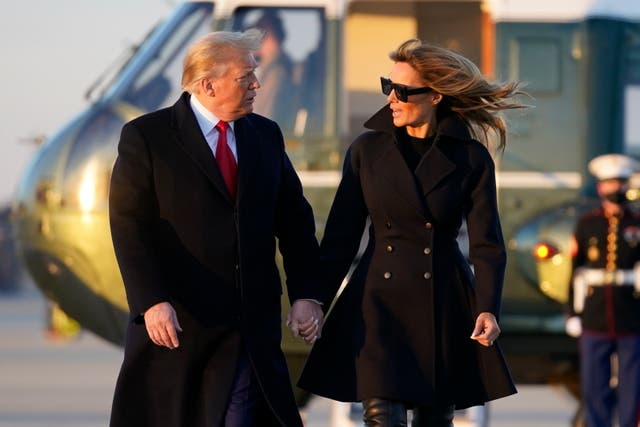 <p>President Donald Trump and first lady Melania Trump walk to board Air Force One at Andrews Air Force Base, Md., Wednesday to travel to Mar-a-Lago</p>