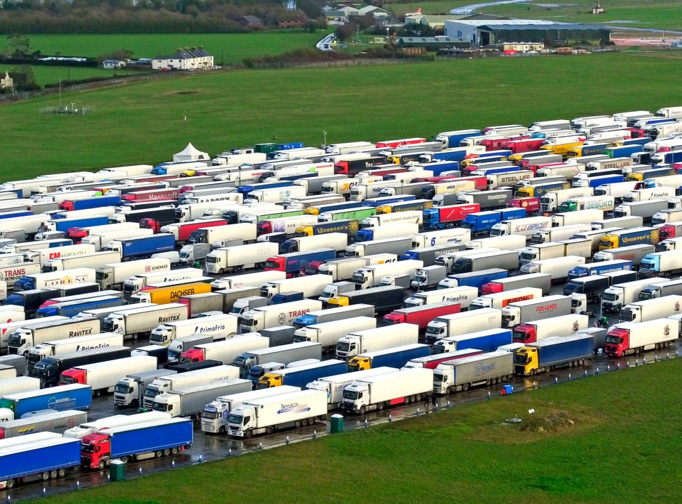 <p>Freight lorries lined up in Manston, Kent, after French authorities announced that journeys from the UK will be allowed to resume after the coronavirus ban was lifted, but those seeking to travel must have a negative test result</p>