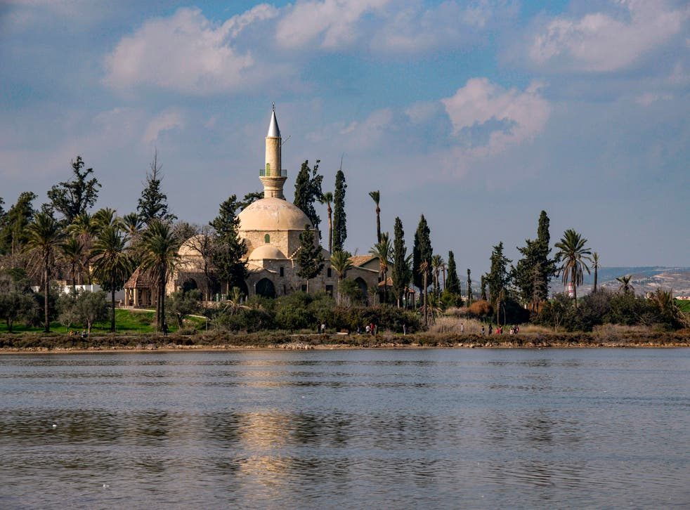 Photo taken on 20 December, 2020 shows a view of the historic 19th century Hala Sultan Tekke mosque overlooking the salt lake in Cyprus' coastal city of Larnaca.