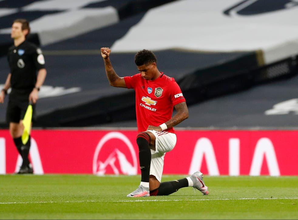 <p>Marcus Rashford takes a knee as the Premier League returns in June</p>