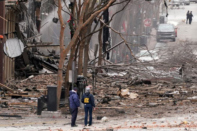 <p>Police in Nashville survey the devastation after a motorhome exploded on Christmas Day</p>