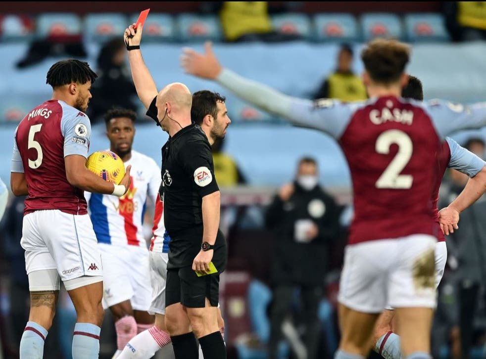 <p>Tyrone Mings is sent off after separate fouls on Wilfried Zaha</p>