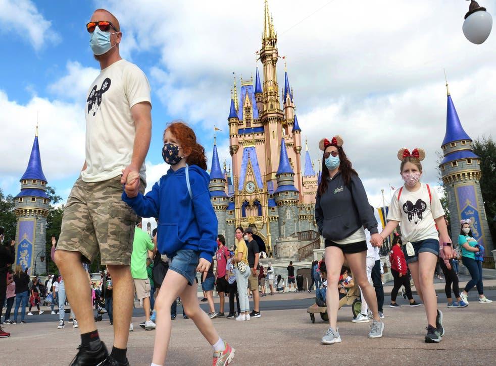 <p>Guests enjoy the Disney park in the coronavirus pandemic.</p>