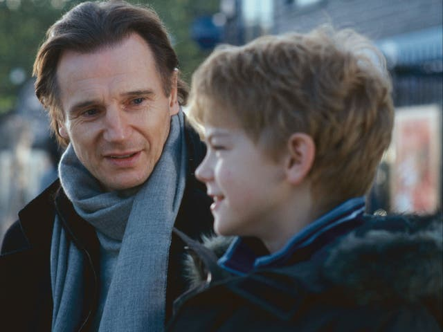 Thomas Brodie-Sangster (right) and Liam Neeson in Love Actually (2003)