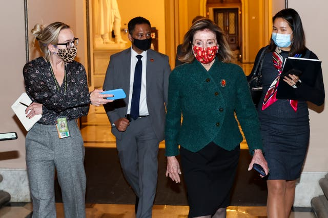 Speaker of the House Nancy Pelosi (D-CA) heads back to her office after leaving the house floor on December 28, 2020 in Washington, DC. President Donald Trump signed a COVID relief bill and government funding bill into law Sunday night, averting a government shutdown.