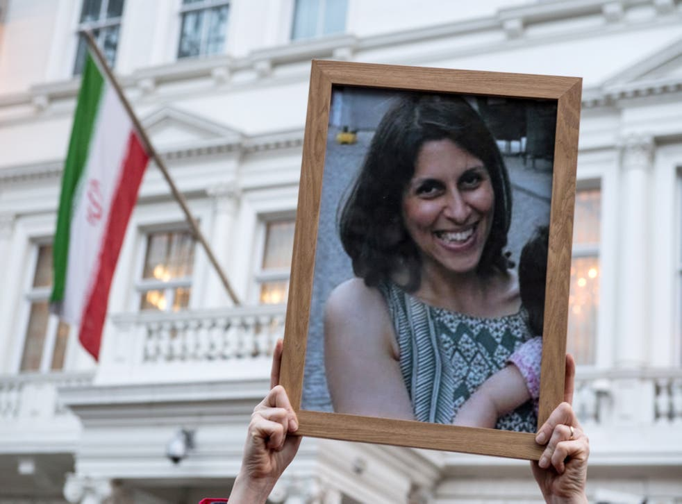 Supporters hold a photo of Nazanin Zaghari-Ratcliffe during a vigil for British-Iranian mother, Nazanin Zaghari-Ratcliffe, imprisoned in Tehran outisde the Iranian Embassy on 16 January, 2017 in London, England. She has been detained in Iran since 2016.