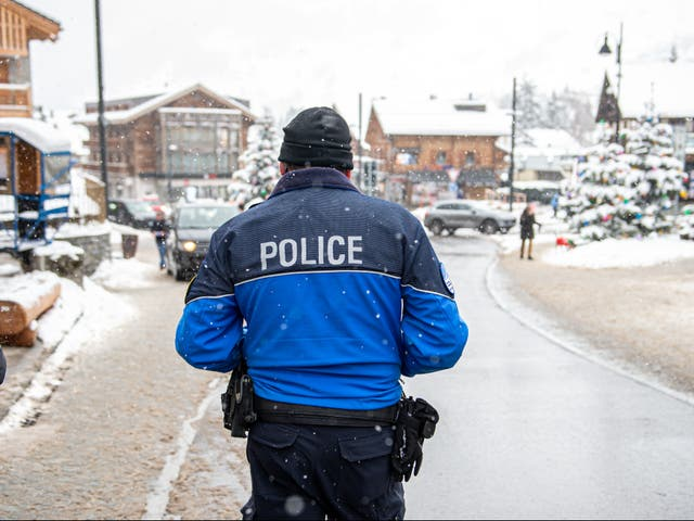 A policeman walks at Verbier centre on 29 December by which time most British tourists are said to have left the resort