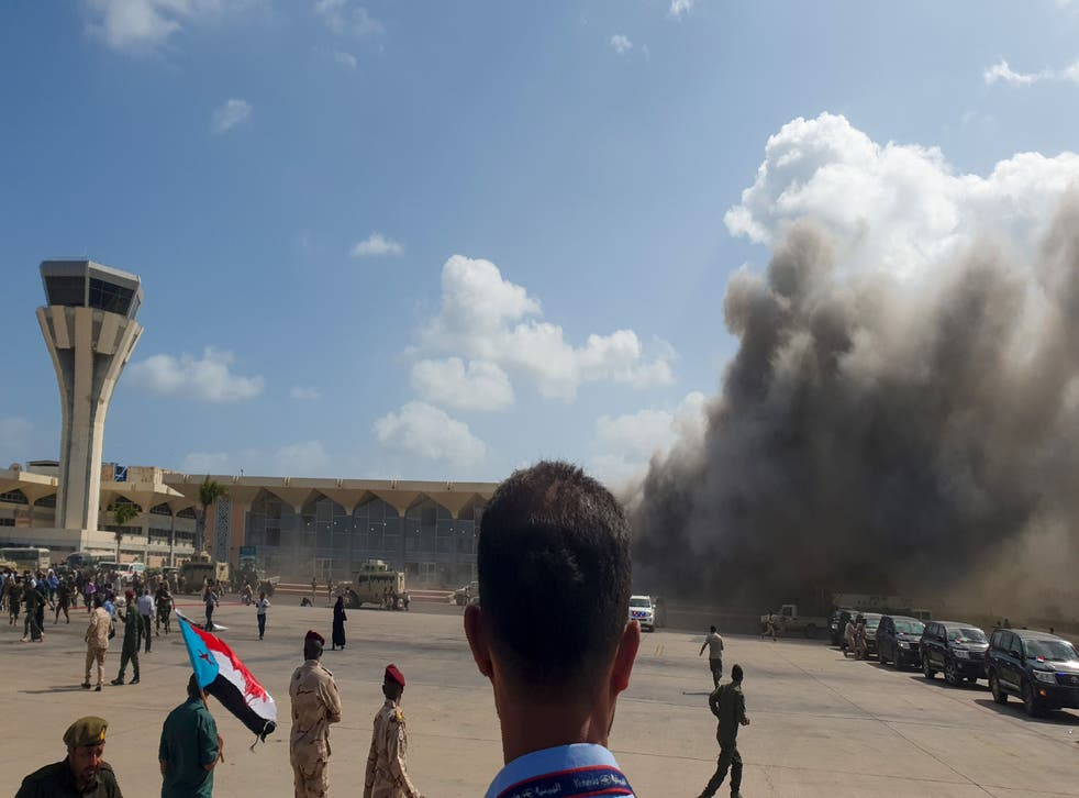 Smoke billows from Aden Airport following the attack which has left at least 25 dead (Photo by Saleh Al-OBEIDI / AFP)