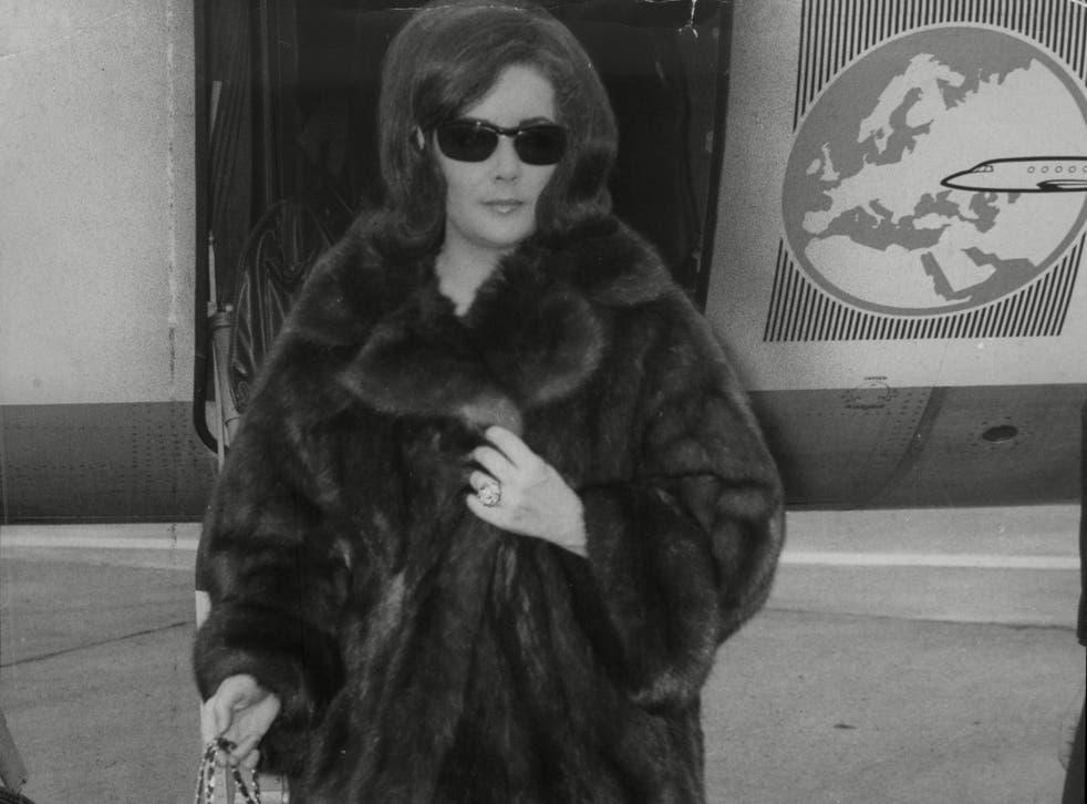 <p>Actress Elizabeth Taylor Wearing A Mink Coat</p>