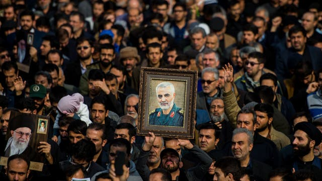 <p>Demonstrators hold up an image of Qassem Soleimani following his death</p>