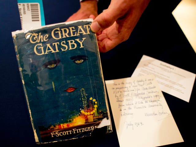 <p>A copy of 'The Great Gatsby' is displayed on 6 June 2013 at Sotheby's in New York. The first edition sold for $112,500</p>