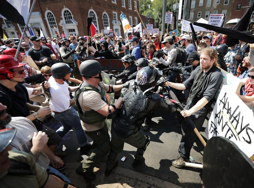 <p>White nationalists, neo-Nazis and members of the alt-right clash with counter-protesters in Virginia</p>