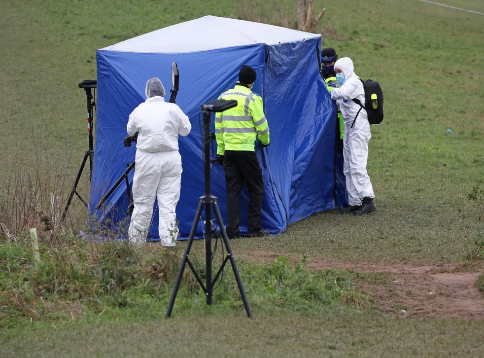 Forensic officers at a tent in Bugs Bottom field in Emmer Green, Reading, where a 13-year-old boy died after being stabbed