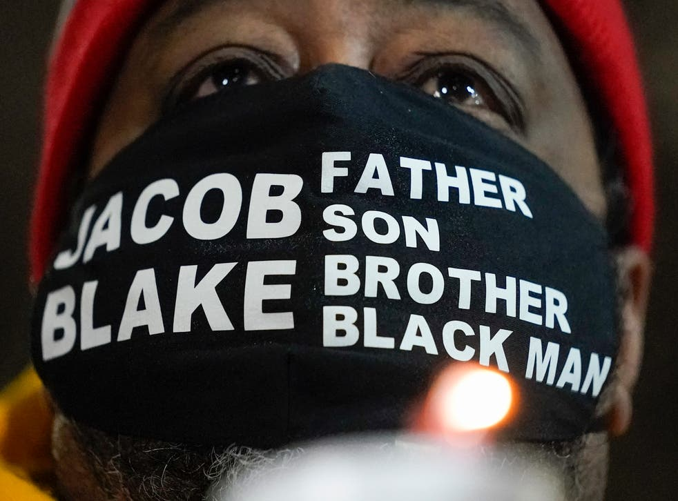 Jacob Blake Sr, father of Jacob Blake, holds a candle at a rally on Monday, 4 January 2021, in Kenosha, Wisconsin