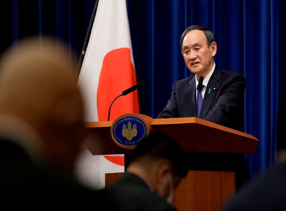 <p>Japanese Prime Minister Yoshihide Suga speaks during a press conference on a state of emergency declared for the greater Tokyo area amid the Covid-19 pandemic</p>