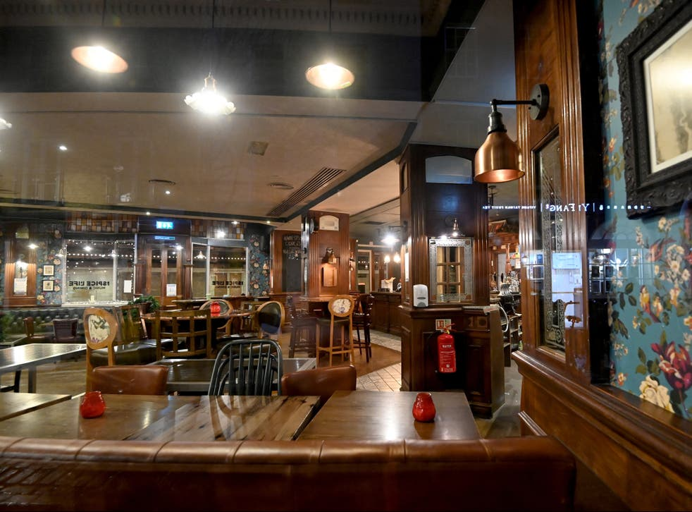 <p>An empty pub after the announcement of more restrictions</p>
