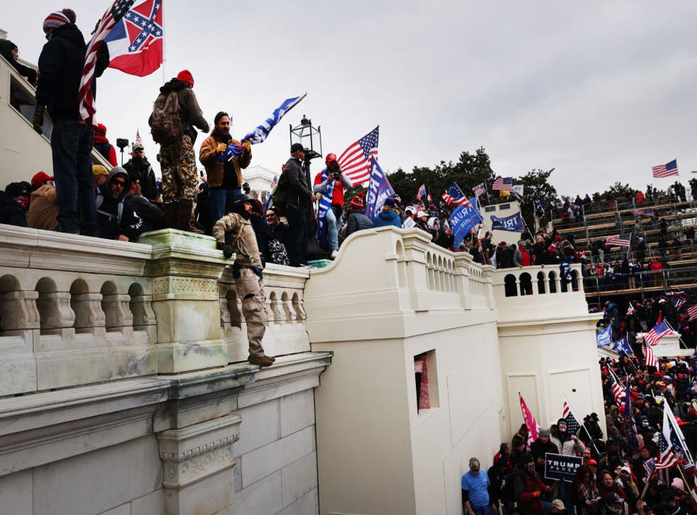 <p>Protesters storm the Capitol in Washington DC on Wednesday</p>