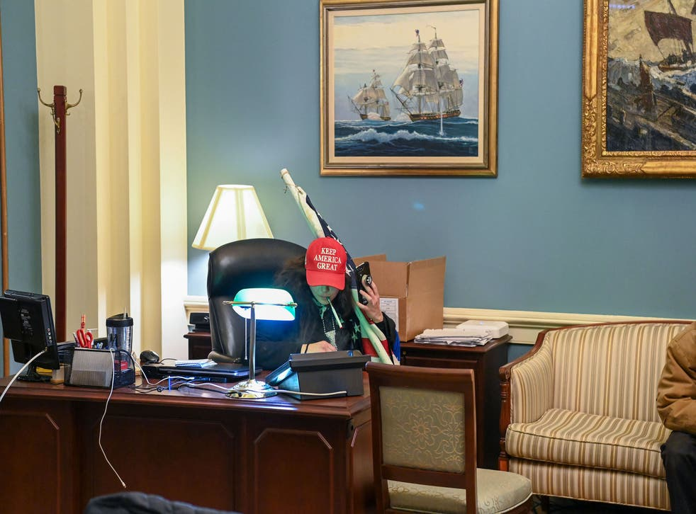 <p>A Trump supporter inside the office of Speaker of the House Nancy Pelosi</p>