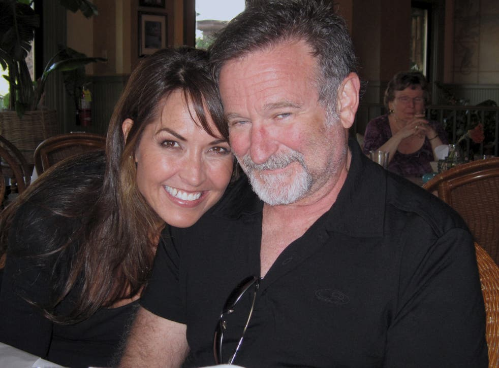 The late comedian Robin Williams and his wife, Susan Schneider Williams, who now works to spread awareness of Lewy body dementia