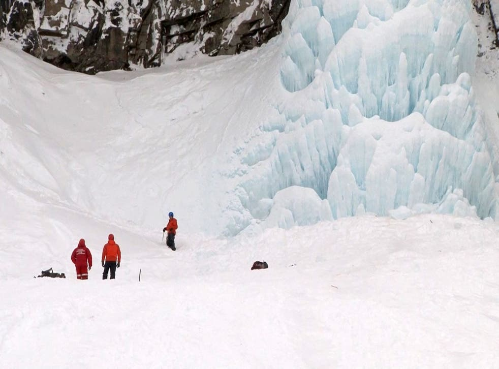 Russian Emergencies Ministry rescue workers respond after a piece of ice fell from the frozen Vilyuchinsky waterfall in Russia's Kamchatka peninsula, trapping four people. One person did not survive their injuries, while a child was taken to hospital in serious condition.