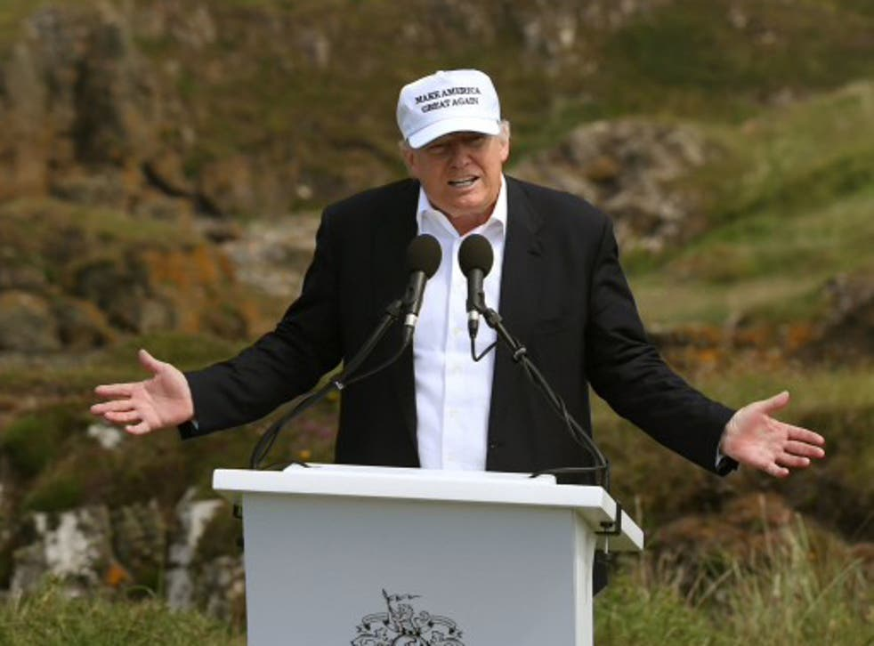 <p>Donald Trump speaks at Turnberry golf course in June 2016, a year after he bought it.&nbsp;</p>
