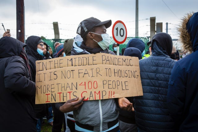 We are victims, not criminals': Asylum seekers protest conditions in military camp | The Independent