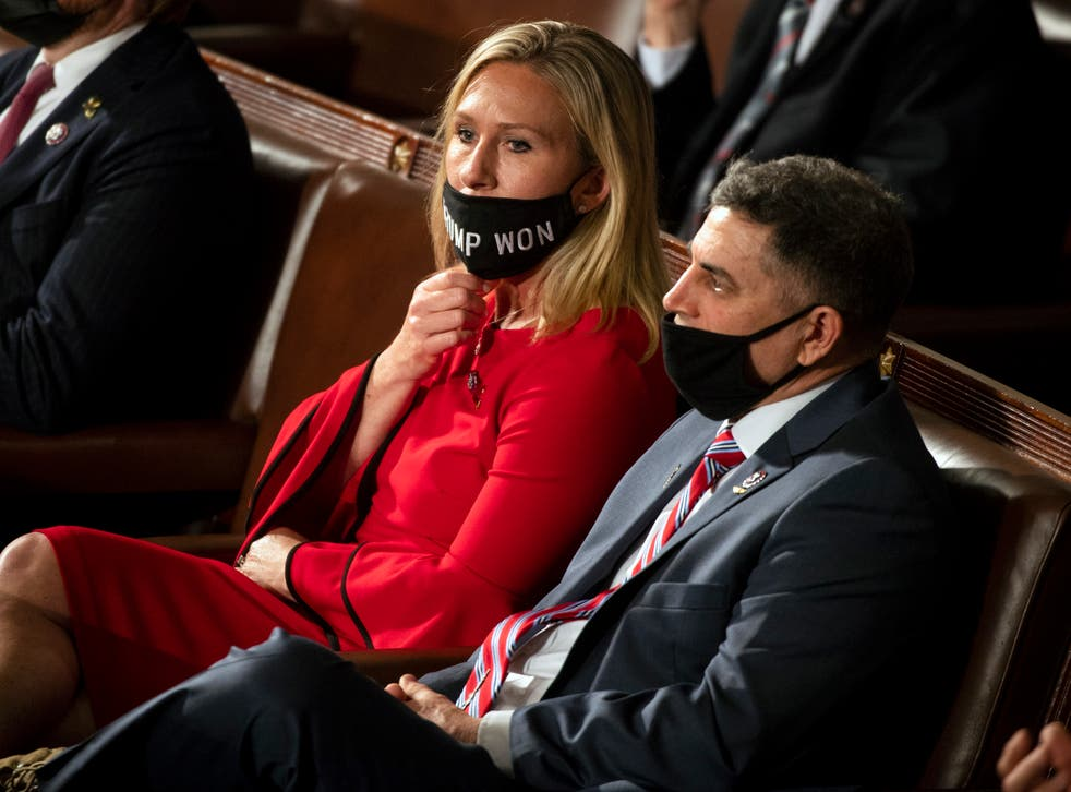 Georgia Republican Congresswoman Marjorie Taylor Greene on the House floor wearing a mask that isn't covering her nose.