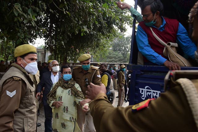 <p>File image: Police detain students during a demonstration to protest against the recent agricultural reforms in Allahabad on 14 December 2020</p>