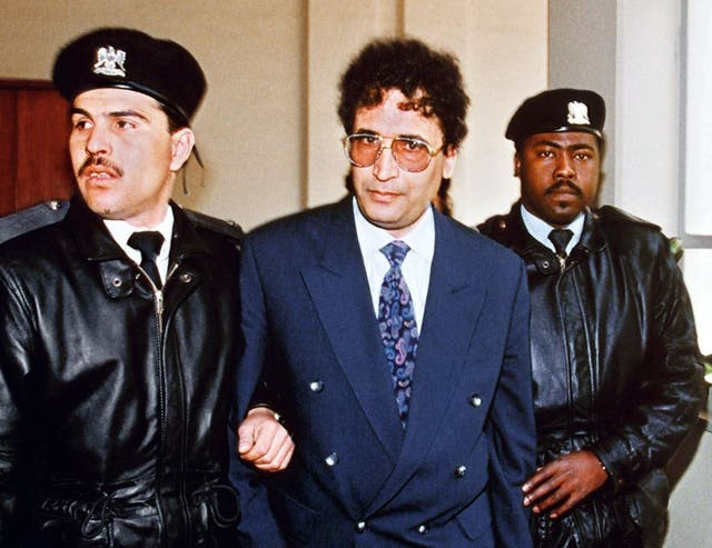 Abdelbaset Ali Mohmet al-Megrahi, later convicted of the Lockerbie bombing, is escorted by security officers on 18 February, 1992.