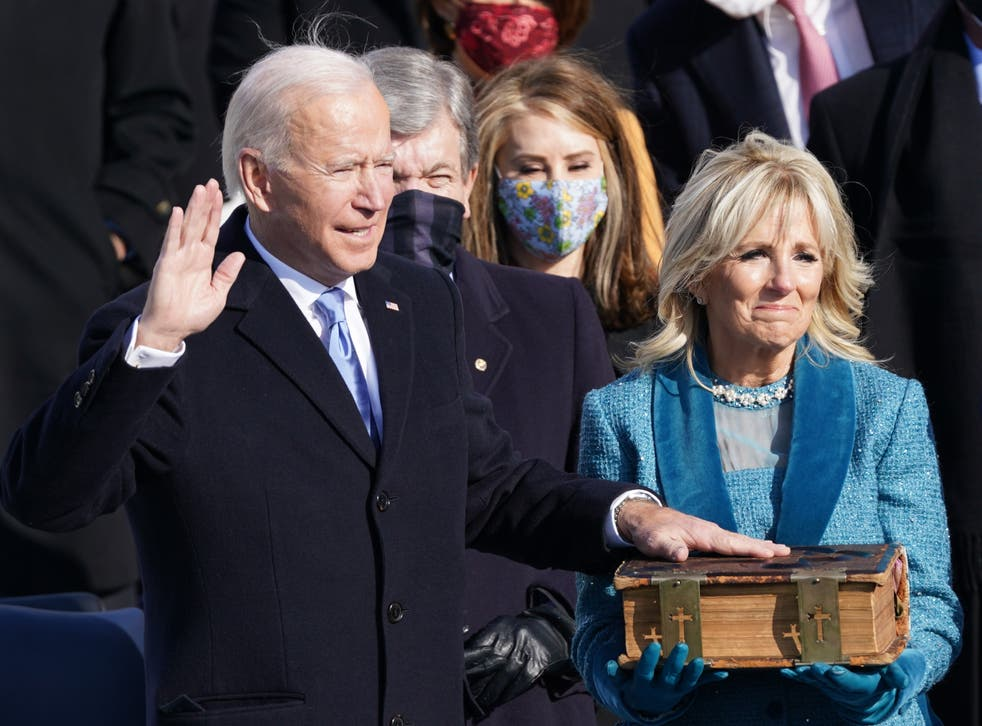pJoe Biden was sworn in as the 46th President of the United States on the West Front of the Capitol while his wife Jill Biden held a bible. The president welcomed a 'day of history and hope' after taking the oath of office saying: 'This is America's day. This is democracy's day.'/p