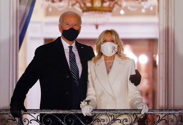 <p>US President Joe Biden and first lady Jill Biden watch fireworks from the White House after his inauguration as the 46th President of the country</p>