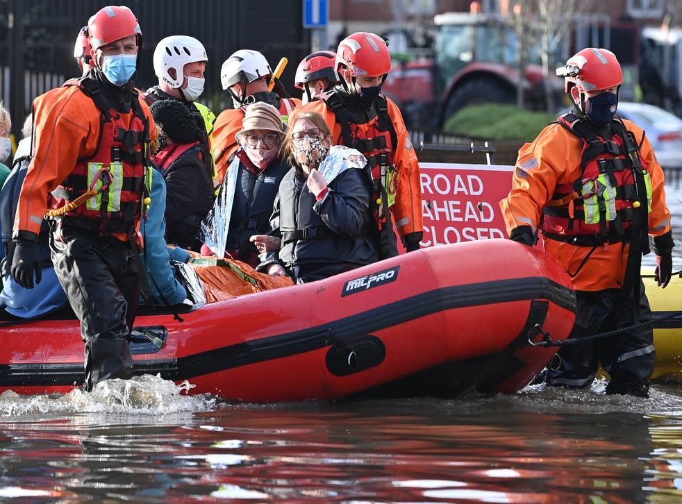 <p>Emergency services evacuate care home residents after they became stranded by flood water, in Northwich</p>