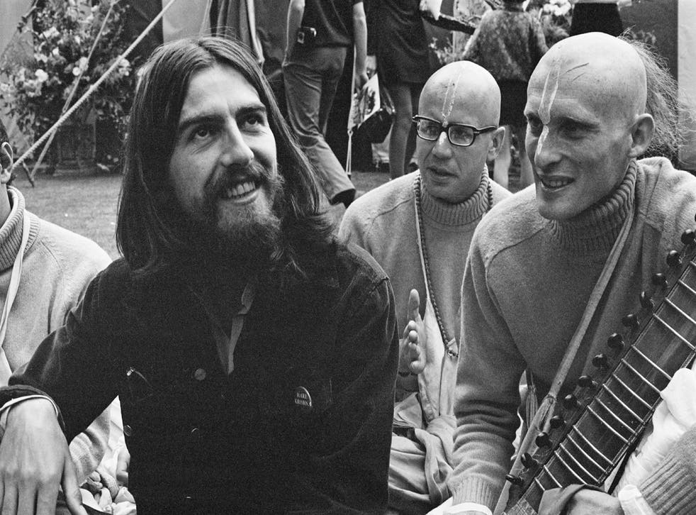 <p>Harrison with members of the Hare Krishna movement, which was an inspiration for his first UK single</p>