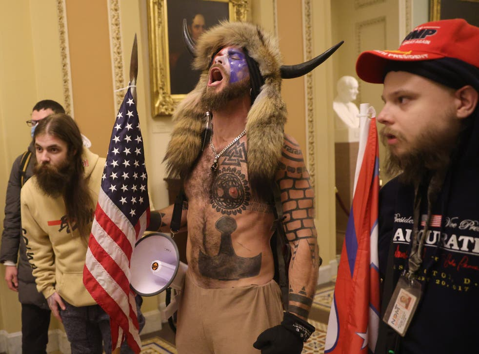 <p>Jacob Chansley, seen here in his horns during the Capitol riot, now blames Donald Trump for his actions</p>