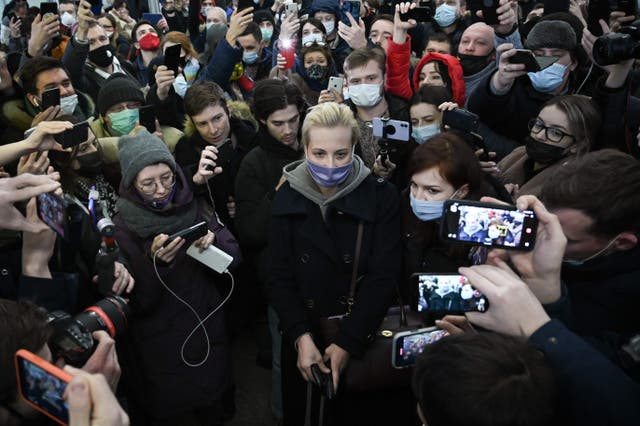 <p>Yulia surrounded by people as she leaves Moscow's Sheremetyevo airport after her husband's arrest earlier this month</p>