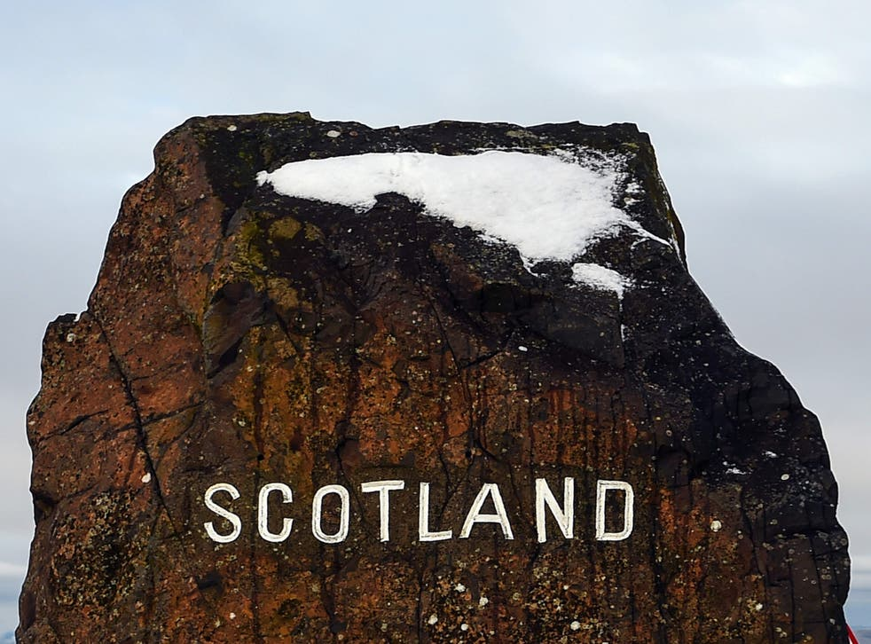 <p>Snow is seen atop a rock on the border between England and Scotland near Jedburgh on 31 December</p>