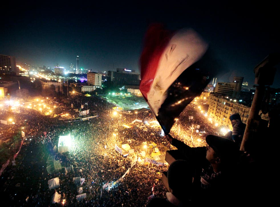 pPeople mark the first anniversary of the popular uprising in Tahrir Square, Cairo/p