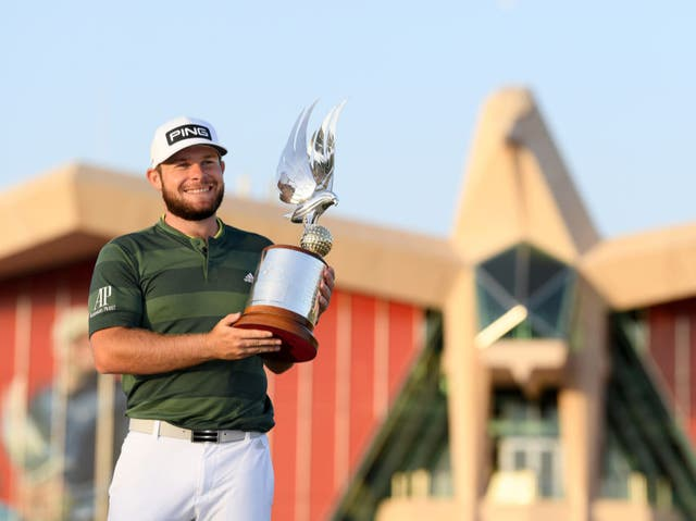 <p>Tyrrell Hatton celebrates with the trophy</p>