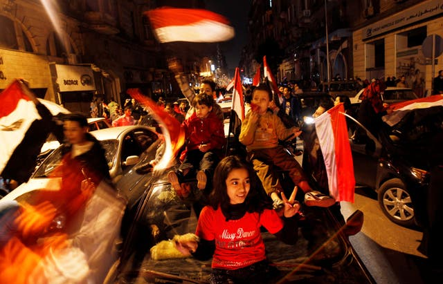 <p>Egyptians celebrate after the announcement of President Hosni Mubarak's resignation in February 2011</p>