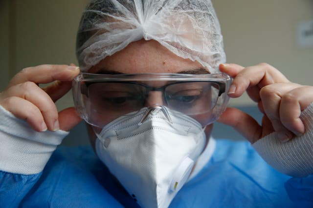 Virus Outbreak Greece ICU Cleaners