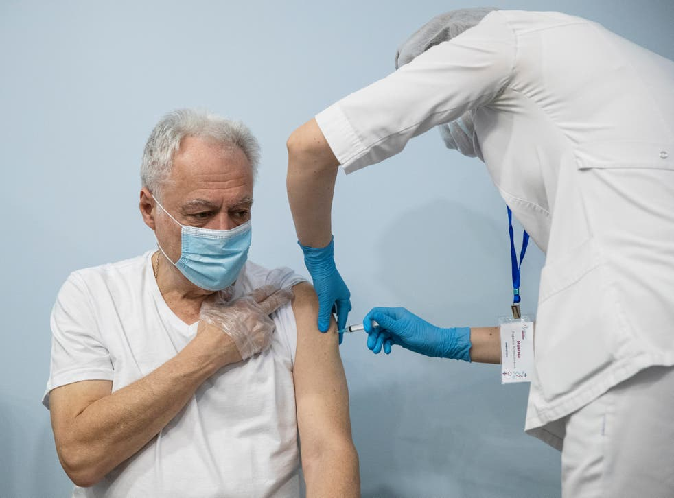 A Russian medical worker administers a shot of the Sputnik V covid vaccine in Moscow
