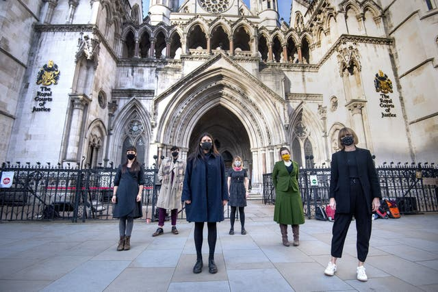 Six members of the so-called Stansted 15 (left to right) May MacKeith, Ben Smoke, Helen Brewer, Emma Hughes, Mel Evans, and Ruth Potts outside the Royal Courts of Justice in London on 24 November 2020